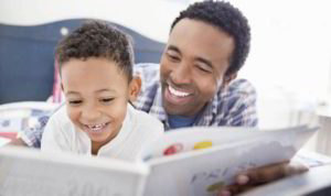 dad-reading-to-his-son-556928-1
